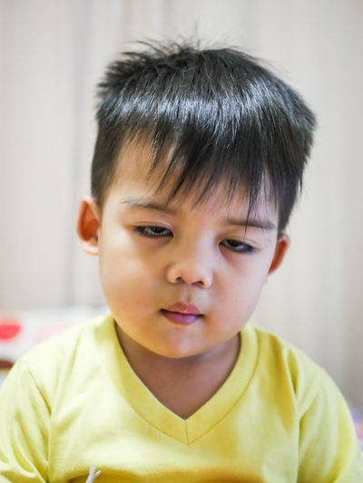 sleepy Child Portrait Headshot Childhood One Person Innocence Close-up Men Males  Front View Casual Clothing Cute Indoors  Boys Emotion Focus On Foreground Hair Offspring Black Hair Hairstyle