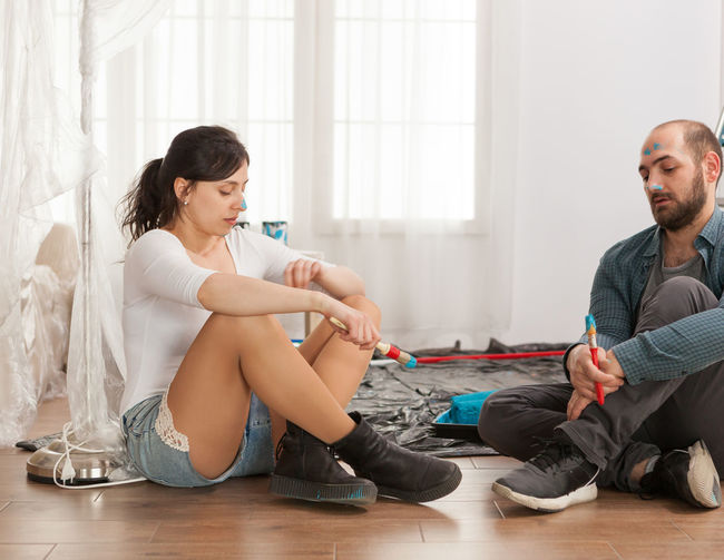 Young couple sitting on floor at home