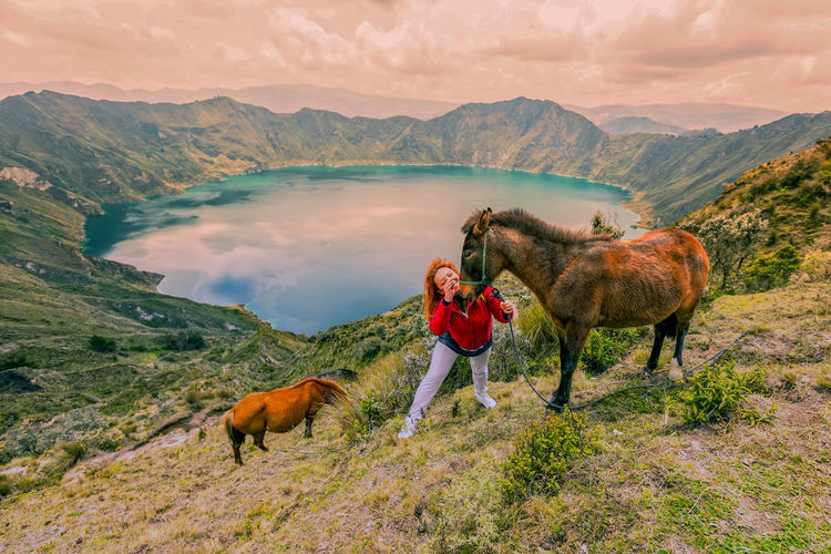 Adventure Beauty In Nature Day Dog Domestic Animals Ecuador Grass Hiking Landscape Leisure Activity Lifestyles Livestock Mammal Men Mountain Mountain Range Nature One Person Outdoors Pets Real People Scenics Sky Standing Travel