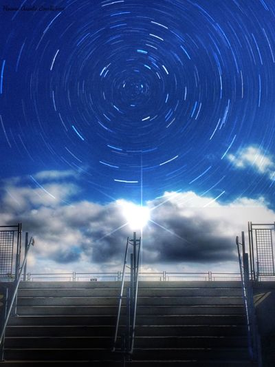 Sky Low Angle View Star Trail Motion Infinity Majestic Astronomy Bright Built Structure Space Night Blue Outdoors Electric Light Concentric Cloud - Sky Space Exploration Modern Beauty In Nature Dramatic Sky Fresh On Eyeem  Fresh on Market 2016 Stars Starscape