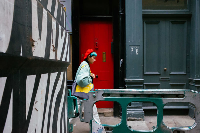 Adult Candid Colorful Colors Door Excentric Fashion Fashionable Full Length Hairstyle Hat Londoners One Person One Woman Only Pattern Red Hair Street Streetphotography Strideby Urban Urban Geometry