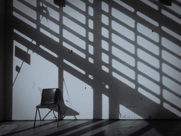 Shadow Indoors  Technology No People Day Everyday Lives London Blackandwhite Blackandwhite Photography Furnitures Chair Pattern Sunlight Interior Hall Community Wall Symmetry