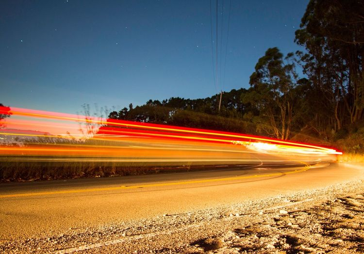 Speed Light Trail Long Exposure Night Motion Blurred Motion Transportation Illuminated Traffic Road High Street Street Light No People Outdoors Red Nature Clear Sky Star - Space Sky Beauty In Nature