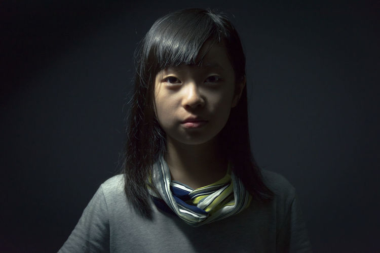 Asian girl portrait at studio light ASIA Black Background Cool Proud Thinking Asiangirl Black Background Black Hair Childhood Chinese Close-up Concentration Day Expression Front View Headshot Indoors  Looking At Camera One Person People Portrait Selfie Serious Smiling Studio Shot