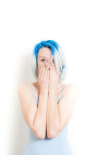Young hipster style girl astonished hands over face Amazed Astonished Blue Hair Copy Space Expression Female Girl Hands Over Face Hipster Human Face Isolated Looking At Camera One Person One Woman Only People Surprised Teen Teenager Woman Young