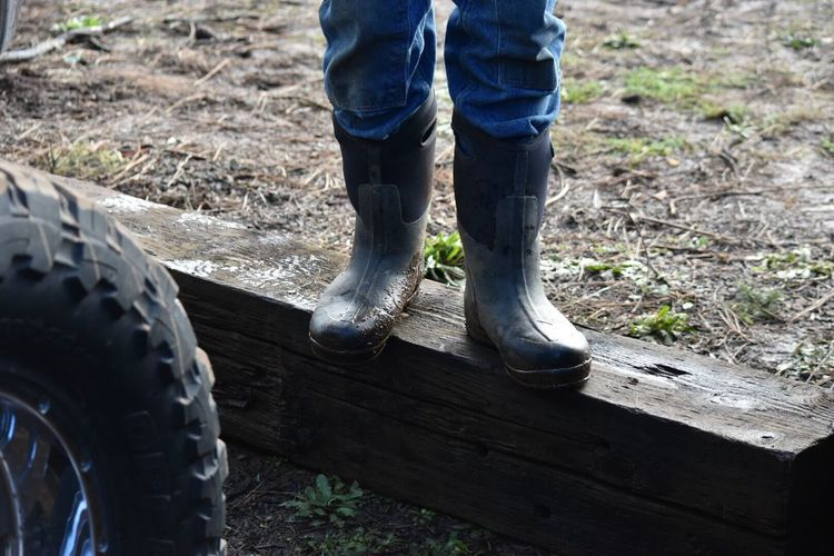 Low Section Human Body Part Standing Occupation Growth Working Close-up Work Tool Day Agriculture Outdoors Adult People Adults Only Only Men Christmas Tree Farm Christmas Time Wintertime Mud Boots Tradition Real People Christmas Tree Traditional