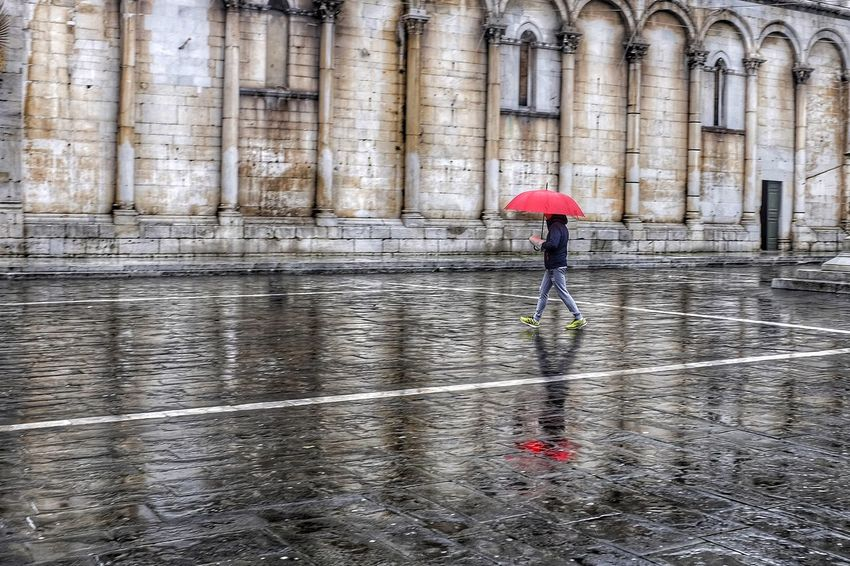 A rainy day in the city of Lucca Lucca Rain Umbrella Reflection Church Rainy Days Outdoor Red Walking Morning Winter X100t Fujifilm City Urban Streetphotography Bad Weather Lonely Piazzasanmichele Tuscany Cityscapes Water Drops Italy Italiancity