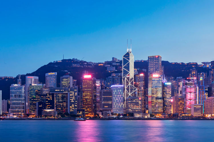 Hong Kong Victoria Harbour Night Night View Blue Sky Victoria Harbour High-rise Building Special Administrative Region Financial Center Prosperous City Pearl Of The Orient Urban Style Tourist Attraction  China Landscape HongKong Tourism Central Shopping Haven Modern Cityscape Development Of Scenery Bustling Building