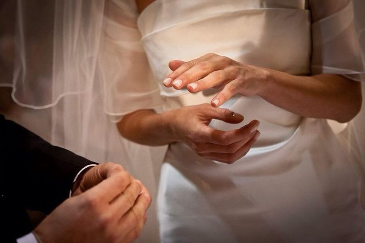 Close-Up Of Bride And Groom Hands