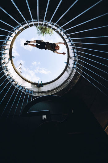 One Person Leisure Activity Full Length Low Angle View Architecture Lifestyles Circular Built Structure Real People Day Sky Skill  Sport Outdoors Movement Jump Parkour Mid-air Panasonic Lumix Lumix G9 EyeEm Best Shots EyeEm Exploring City Architecture Lines