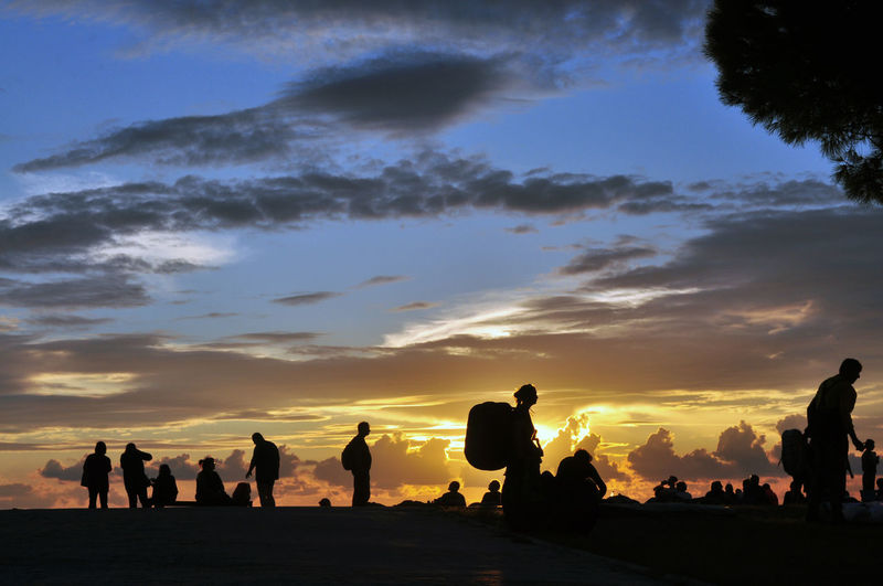 Silhouette of people at sunset