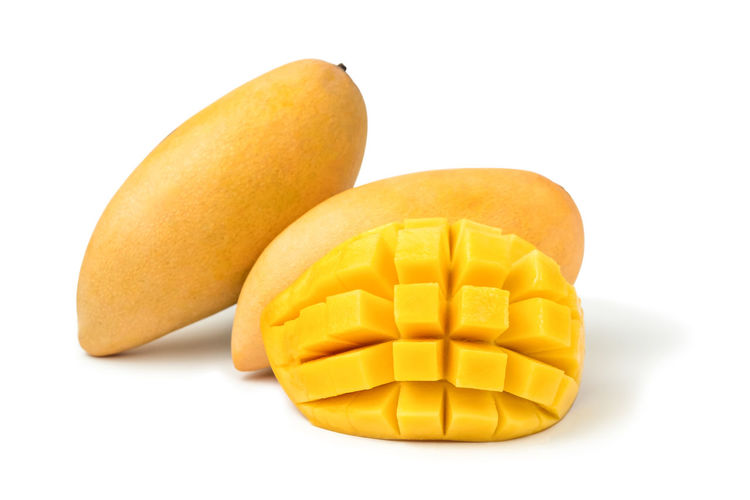 Mango fresh fruit with cubes and slices. Isolated on a white background and clipping path. Mango Isolated White Background Fruit Food And Drink Cut Tropical Organic Ripe Healthy Eating Sweet Dessert Juicy Slices Cubes Yellow Natural Object Macro Studio Nutrition Diet Gourmet Vegetarian Exotic Clipping Path South Citrus  Vitamins Closeup Pieces Sliced Stone CutOut Half Pattern Studio Shot Cut Out Food Indoors  Freshness No People Group Of Objects Snack