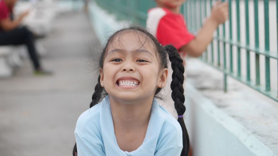 Teeth EyeEm Selects Childhood Child Girls Portrait Smiling Females Positive Emotion Day Cute Front View Innocence People Casual Clothing Looking At Camera Headshot Happiness Women Emotion Offspring Real People