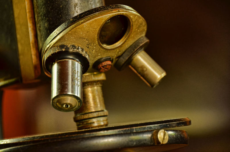 Close-Up Of Old Rusty Microscope