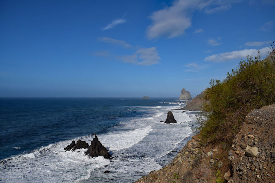 On the beach of Taganana in the northeast of the island of Tenerife -Am Strand von Taganana im Nordosten der Insel Teneriffa, Canary Islands Beach Beauty In Nature Blue Sky Cliff Cloud - Sky Day Horizon Over Water Nature No People Outdoors Rock - Object Scenics Sea Sky Sunlight Taganana Tenerife Tenerife Island Teneriffa Tranquil Scene Tranquility Water Wave