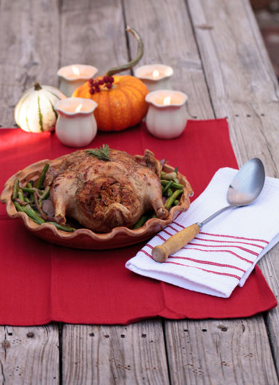 High angle view of roast chicken in container on table