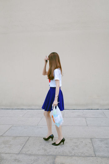 Full length of woman walking on street