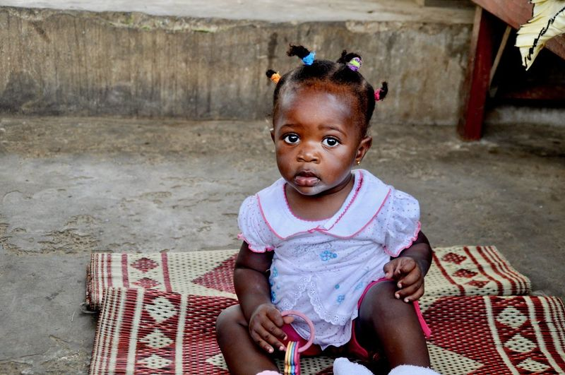 African Innocence Cute Real People One Person Childhood Portrait Sitting Front View Babyhood Child Toddler  Casual Clothing Africa African Ghana Poverty African Beauty Babygirl Developing Country Social Issue Faces Of Africa Carpet Human Face Innocence Toddler  Sitting Toddler  Sitting Looking At Camera