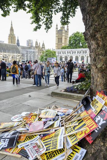 "Placards on concrete floor of Parliament Square during the ""Not One Day More"" protest against the Conservative government on July 1, 2017 in London, UK. Activists London Protest Activism Demonstration Lying On Ground Not One Day More Outdoors Parliament Square People Placards Political Politics And Government Posters Protesters"