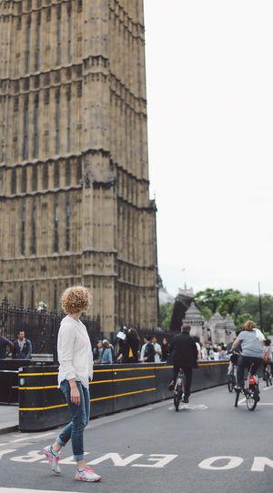 Full Length Of Woman Walking On Road Against Big Ben