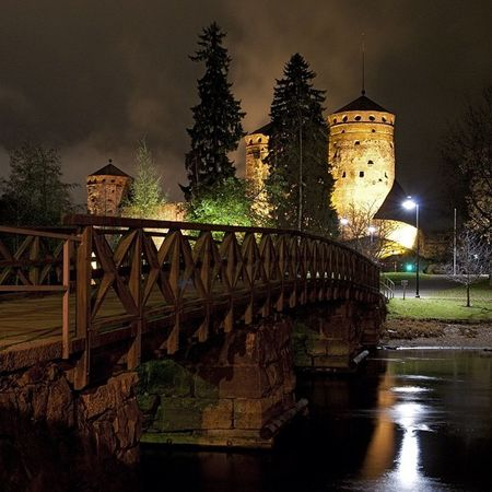 Finland Savolinna Olavinlinna November evening water bridge bestofscandinavia