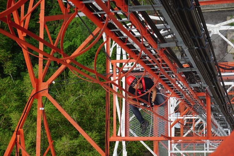 Engineer repairing rollercoaster