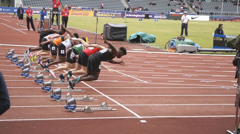 Sports Track Sport Sports Race Running Track Competition Running Track Event Track And Field Competitive Sport Large Group Of People Stadium Track And Field Athlete Outdoors Horse Racing Starting Line Men's Track Athlete Track Starting Block Spectator Day