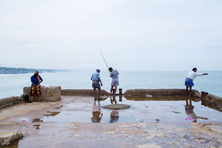 People fishing in sea