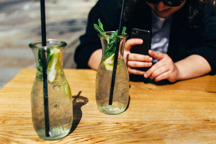 Brunch Close-up Day Drink Focus On Foreground Indoors  Lemonade Nature One Person People Photographing Portable Information Device Real People Smart Phone Summer Sunny Table Taking Photos Technology Wireless Technology