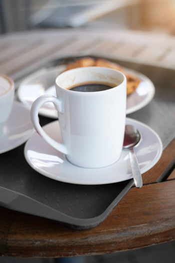 Porcelain cup with coffee on a tablet. mock up offers space for your own designs.