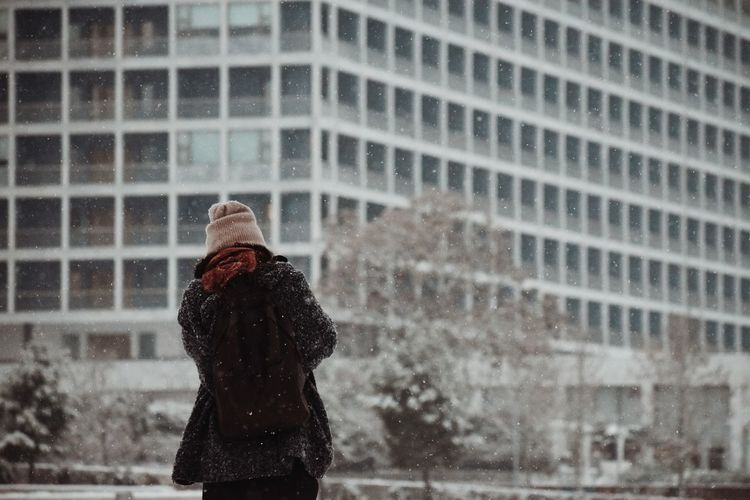 Rear View Of Woman Standing In City During Winter