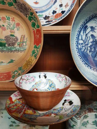Close-up of chinese crockery on shelf