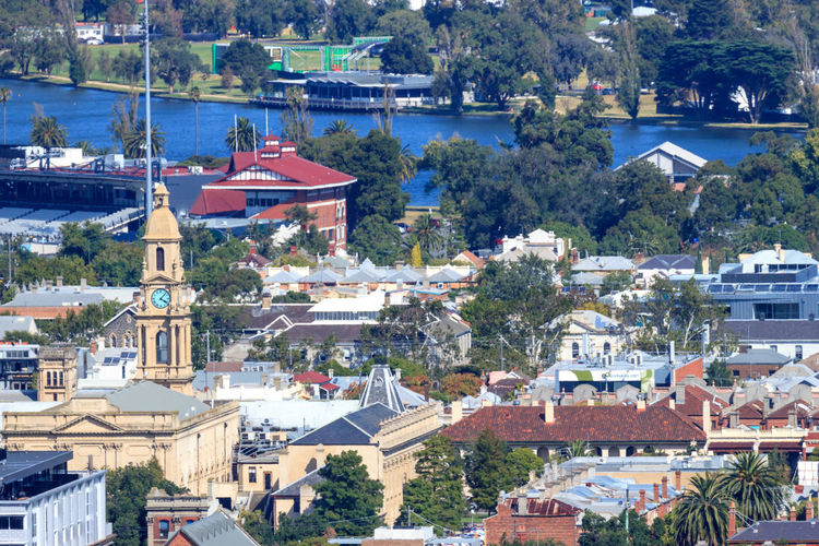 High angle view of south melbourne townscape and city hall by trees and albert park lake
