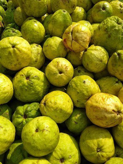 Full frame shot of guavas for sale in market