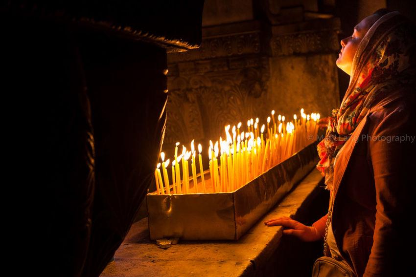 Prayer by the candles, Jerusalem. Atmosphere Candle Light Candles Christian Christianity Church Devotion Documentary Faith God Holy Holy Sepulchre Illuminated Jerusalem Jesus Mood Night Pilgrim Pilgrimage Pray Praying Religion Religious  Wish Woman