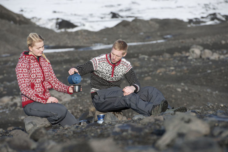 Men sitting on rock
