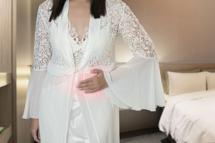 The woman in silk nightwear and white robe wake up for go to the bedroom, Women with menstrual disorders at night, Menstrual cramps, Irritable Bowel Syndrome or IBS Menstrual Disorders Period Cramp Menstruation Irritable Irritablebowelsyndrome Bowel Syndrome Stomachache Stomachache Pain Stomach