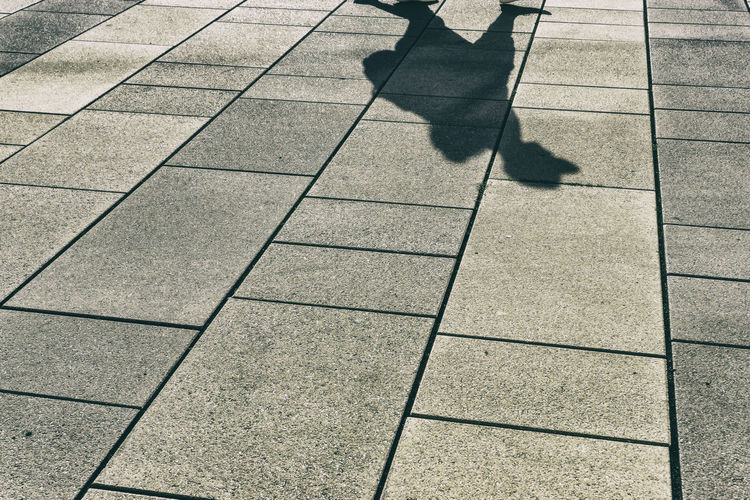 Tiled floor with shadow of pedestrian walking by Germany 🇩🇪 Deutschland Horizontal Potsdam Color Image Ground Outdoors Pedestrian People Public Square Shadow Tiles Walking By