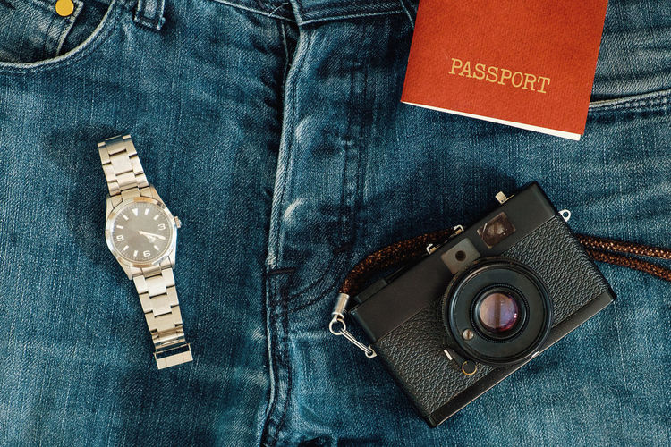 ready to travel Passport Travel Traveling Blue Camera - Photographic Equipment Casual Clothing Close-up Clothing Communication Denim Digital Camera Fashion Indoors  Jeans No People Photographic Equipment Photography Themes Pocket  Technology Text Textile