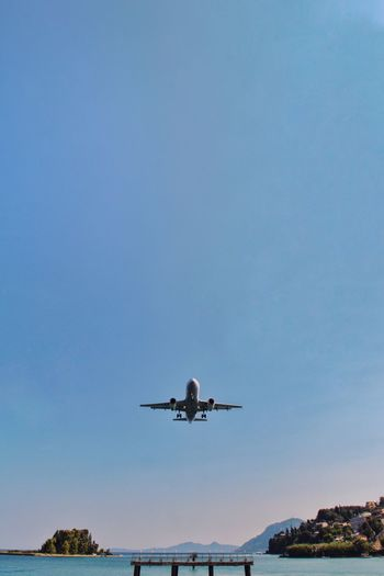 Fly away Blue Travel Low Angle View No People Nature Outdoors Airport Aerospace Industry Commercial Airplane Motion Water
