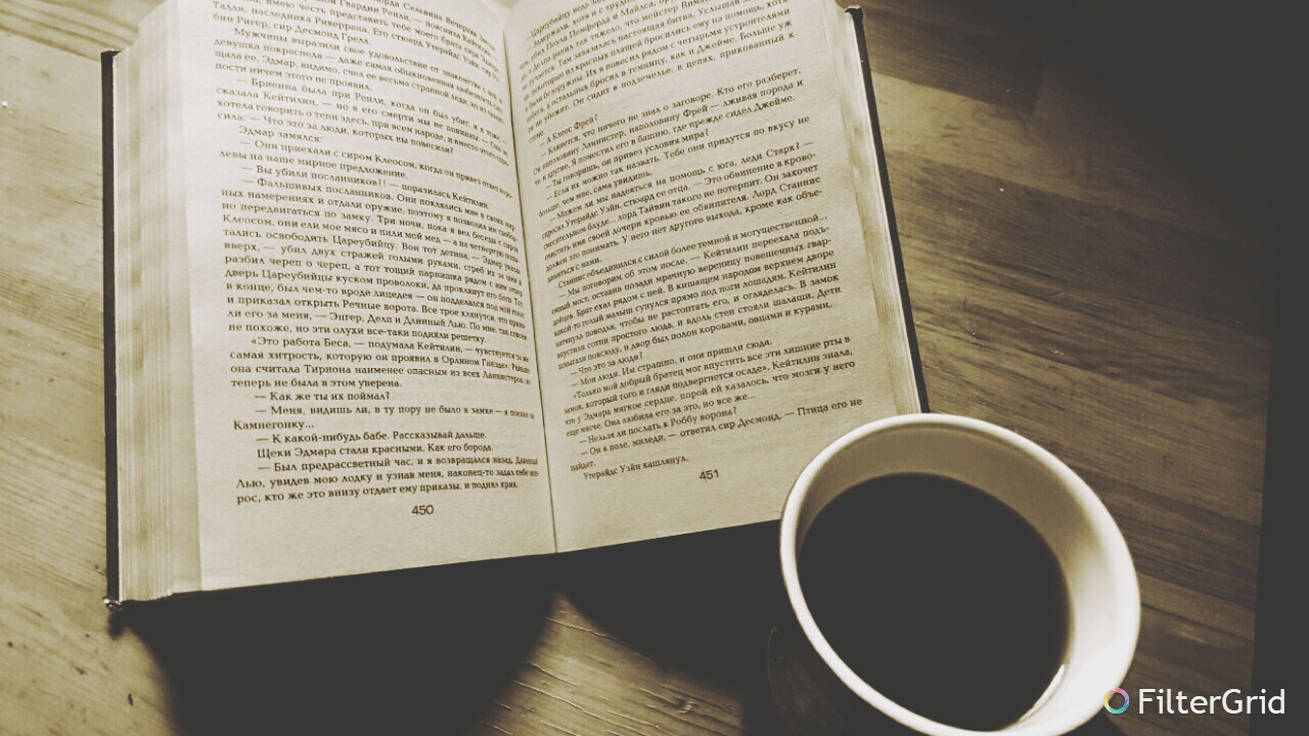 indoors, table, communication, text, still life, book, coffee cup, western script, education, paper, food and drink, coffee - drink, close-up, high angle view, drink, wood - material, refreshment, coffee, pen, cup