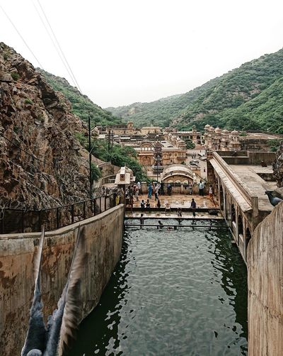 Bathing India Place Of Worship Travel Photography Traveling Architecture Beauty In Nature Building Exterior Built Structure Day Flowing Water Incredible India Lifestyles Mountain Nature Outdoors Pigeon Rajasthan Scenics - Nature Sky Temple Tranquil Scene Travel Destinations Water