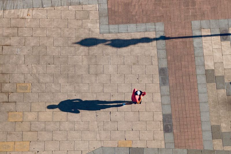 High angle view of man on footpath