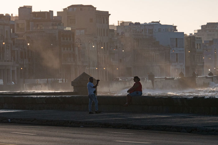 Malecon, November 2016 Before Sunset Coastline Adult Architecture Building Exterior Built Structure City Day Evening Friendship Full Length Leisure Activity Lifestyles Malecón, La Habana Outdoors People Real People Sea Sky Splashing Waves Two People