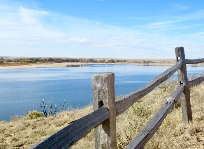 Wooden fence above reservoir in Colorado Landscape Travel View Water Lake Reservoir Wooden Fence Fence Water Sky Tranquil Scene Tranquility Beauty In Nature Wood - Material Nature Day Scenics - Nature Railing No People Outdoors Cloud - Sky
