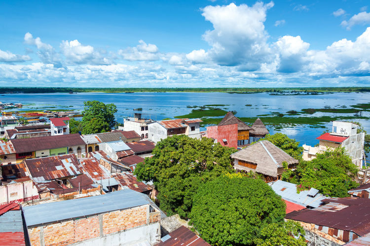 Cityscape view of Iquitos, Peru with the Itaya River in the background in the middle of the Amazon Rain Forest Amazon America Beauty Blue Brazil City Forest Green Iquitos  Iquitos, Perú Jungle Landscape Natural Nature Outdoors Peru Peruvian Rainforest River Scenics Sky Street Travel Tropical Water