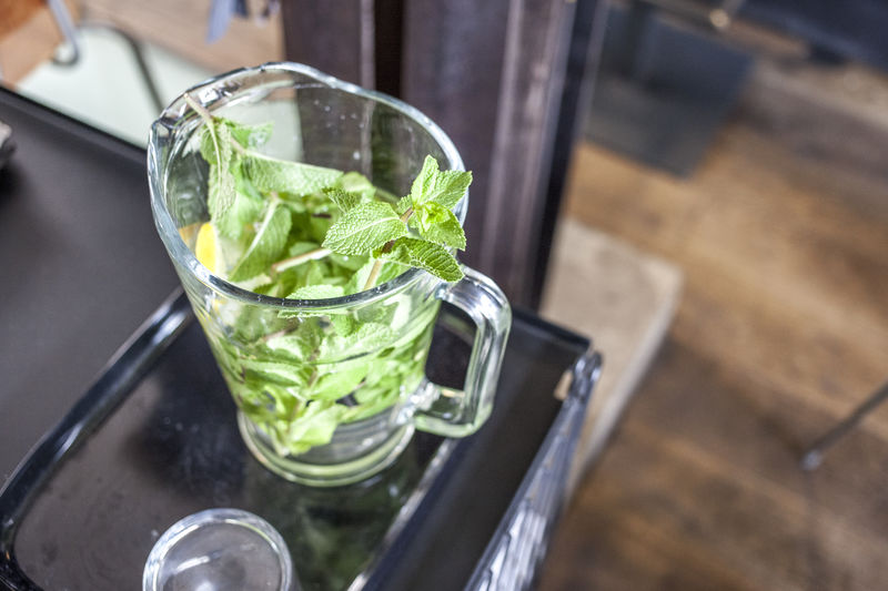 Fresh mint leaves in mixing glass