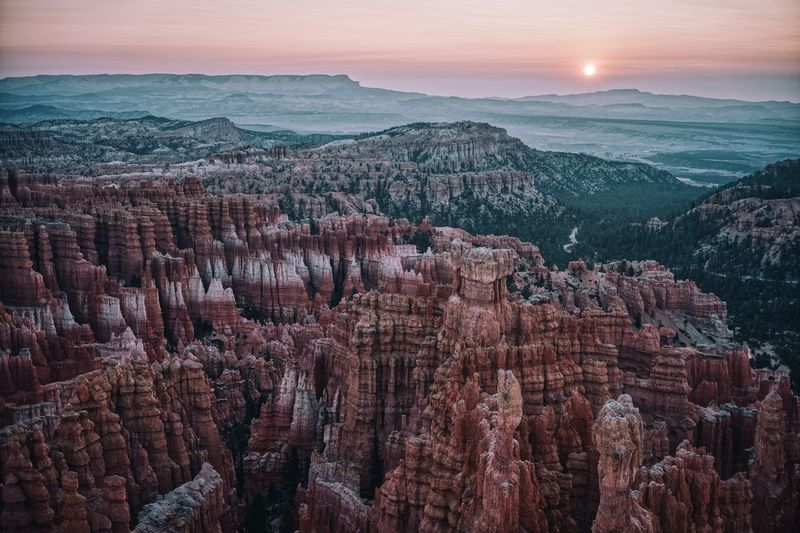 Panoramic view of bryce canyon landscape with sunrise in background
