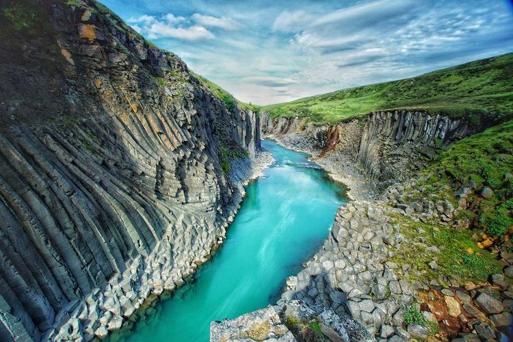 Panoramic shot of water flowing through rocks