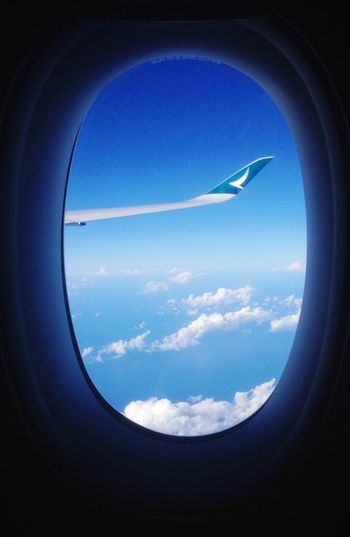 Low angle view of airplane wing over sea